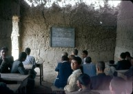 """Chemistry lesson in a mud-walled classroom. """