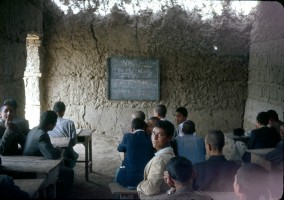 """""""Chemistry lesson in a mud-walled classroom. """""""