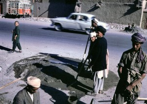 """Afghan workers make a street repair in Kabul."""
