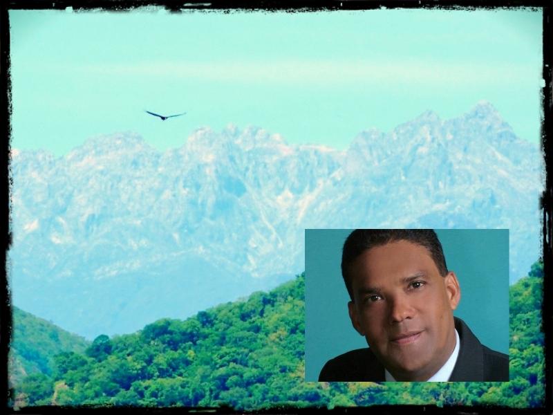 Fotomontaje de un rostro sobre un fondo de montañas y cielo